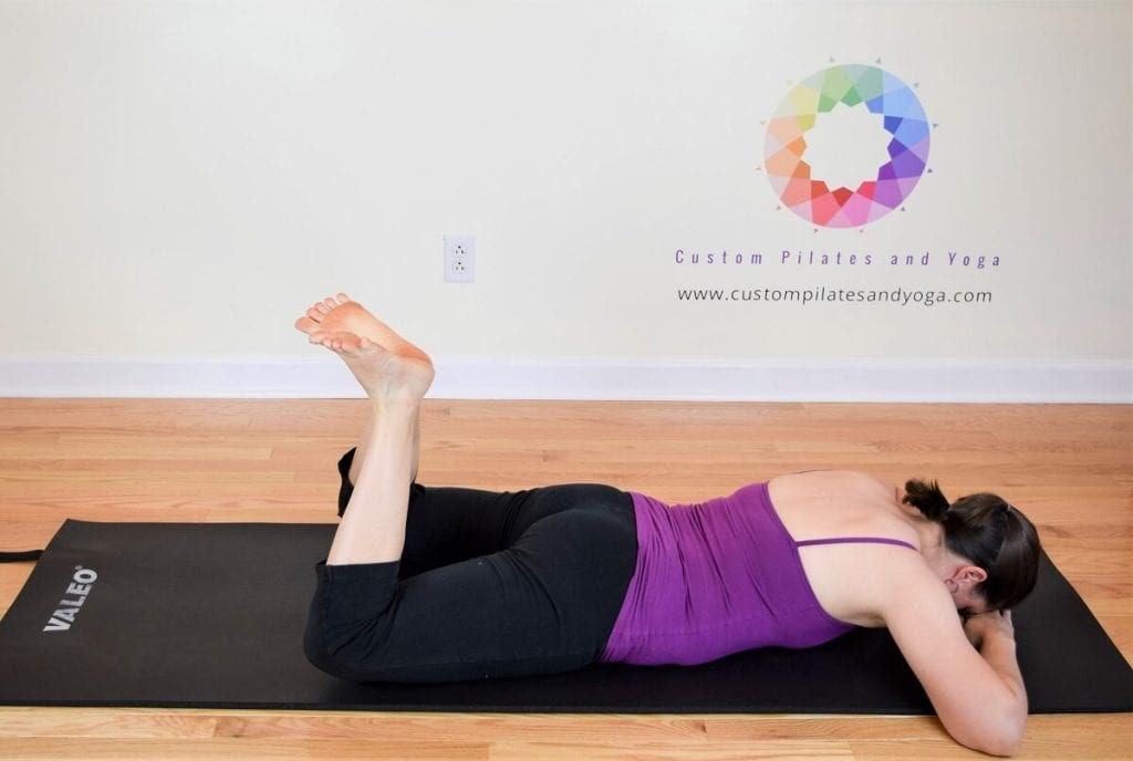 Sarah Stockett doing pilates heel squeeze