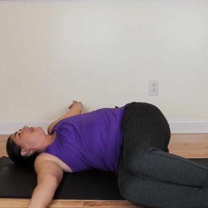 Sarah Stockett doing Pilates spinal rotation